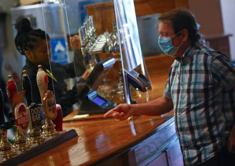 England's pubs, restaurants and hairdressers reopen