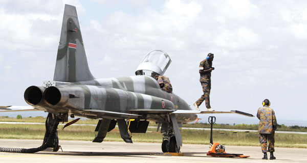 Soldiers on an F-5 fighter jet. BELOW: Tucano trainer jet (left) and Mi 17 (right). DOWN: Kenya Airways Boeing 777 300ER. [PHOTOS: COURTESY/STANDARD]