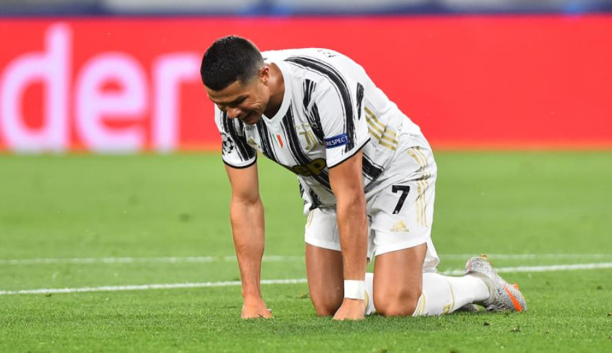 Ronaldo goals not enough as Lyon knocks Juventus out of UCL
