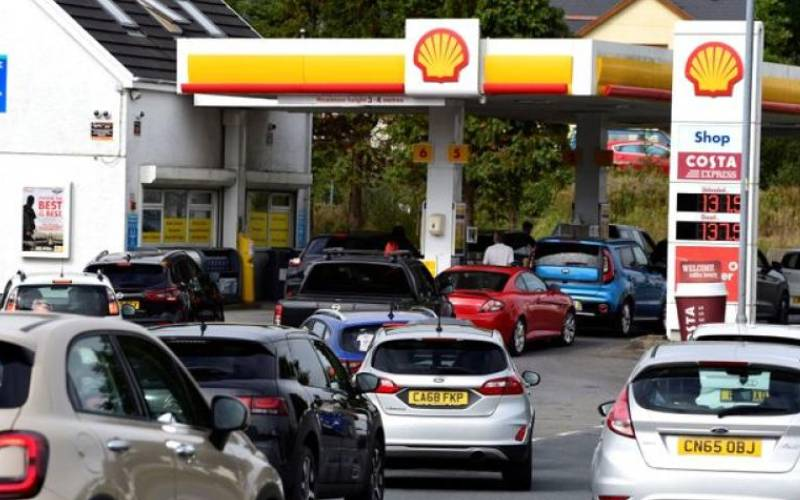 Behave normally, fuel-starved Britons told
