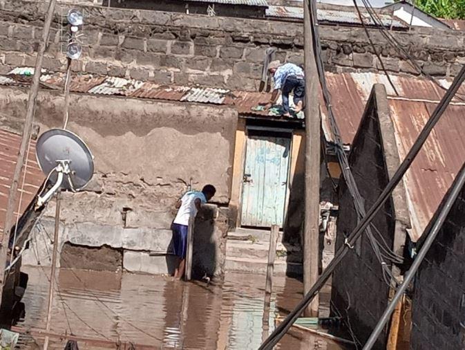 Residents of Shabaab estate in Nakuru Town count losses following heavy rains. (Photo: Kennedy Gachuhi)