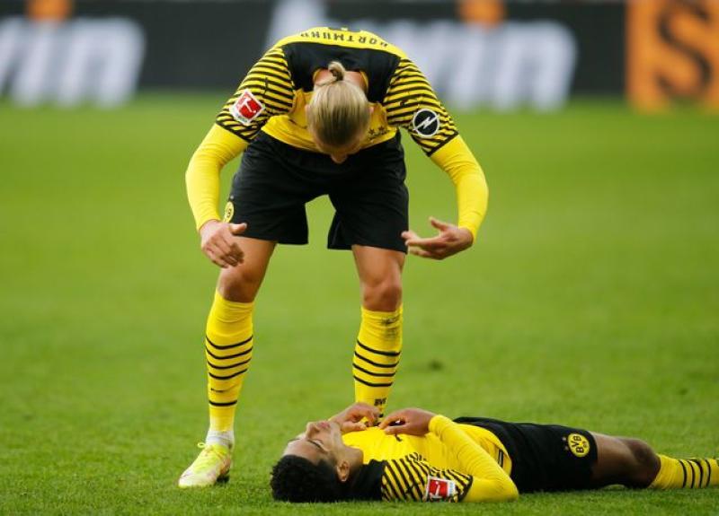 Haaland scores twice on return to send Dortmund top of Bundesliga