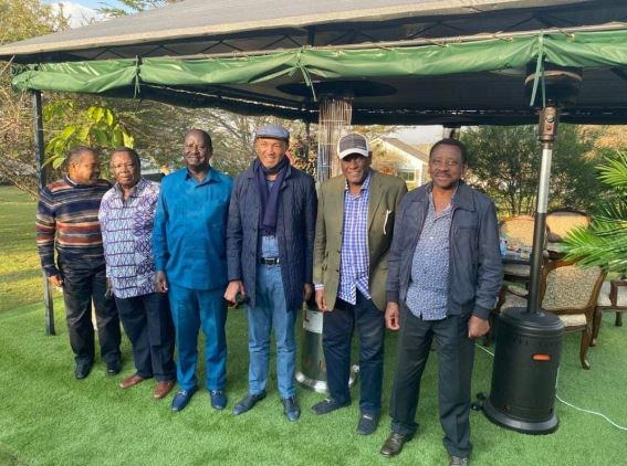 Igembe North MP Maoka Maore, Francis Atwoli, ODM leader Raila Odinga, Peter Kenneth, David Murathe and Senator James Orengo pose for a photo after a meeting at Atwoli's Kajiado home.