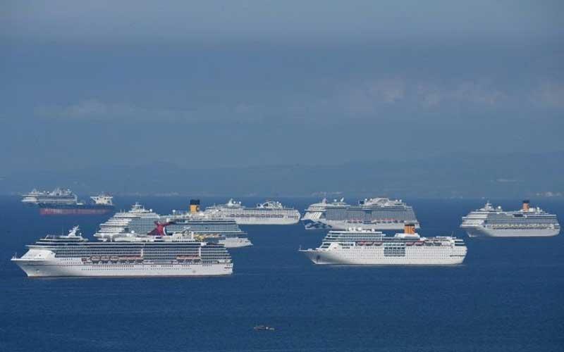 Stranded on ships, 200,000 seafarers struggle in virus limbo