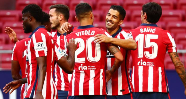 Suarez scores twice, gets assist as Atletico lay down marker