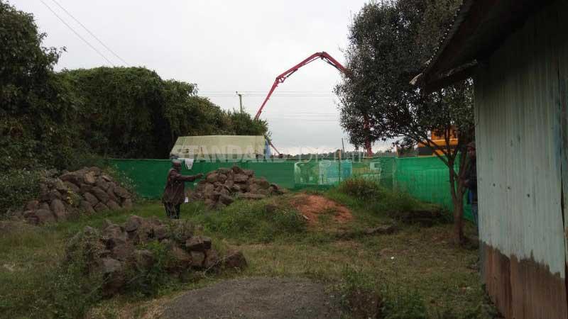NLC behind Sh15b train land racket