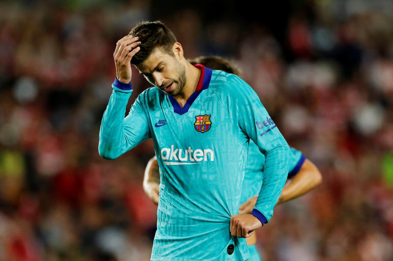 Barcelona's Pique cycled to derby match with Espanyol
