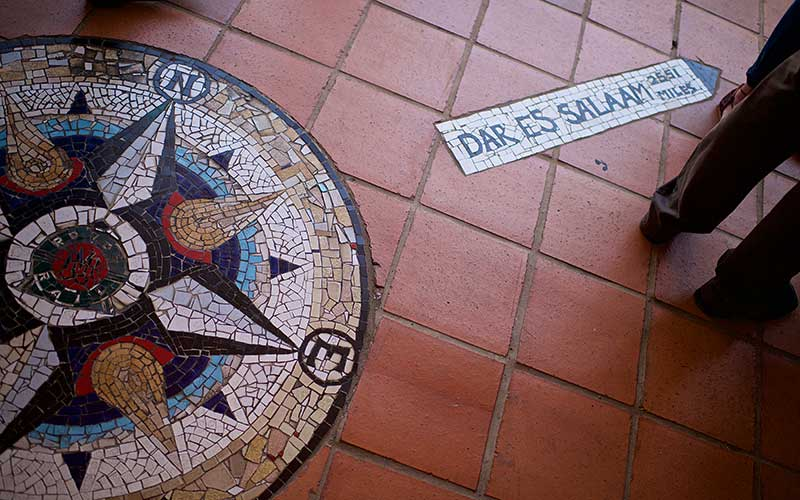 Mosaic tiles directional sign to Dar Es Salaam with distance given in miles Pretoria South Africa