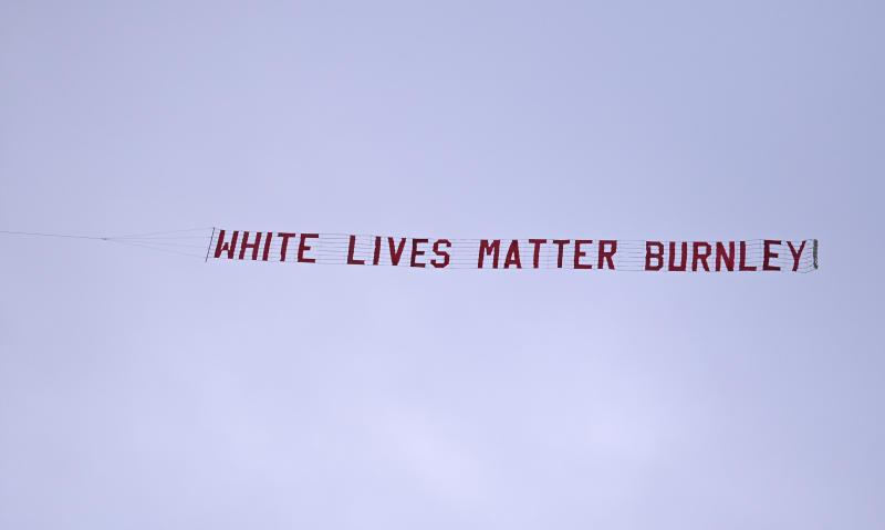 Burnley fan behind 'White Lives Matter' banner sacked