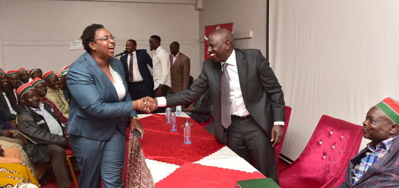 Malindi MP Aisha Jumwa greeting Deputy President William Ruto during a meeting with African Divine Church members to convince them to vote for McDonald Mariga in forth coming Kibra by-election (Photo: