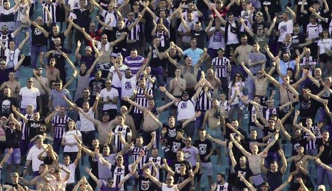 Football fans break distancing rules at final