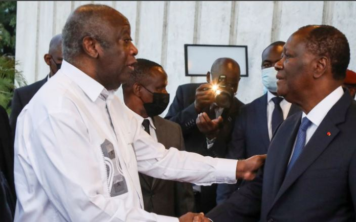 'Happy to see you': Ivory Coast political rivals hug in reconciliation push