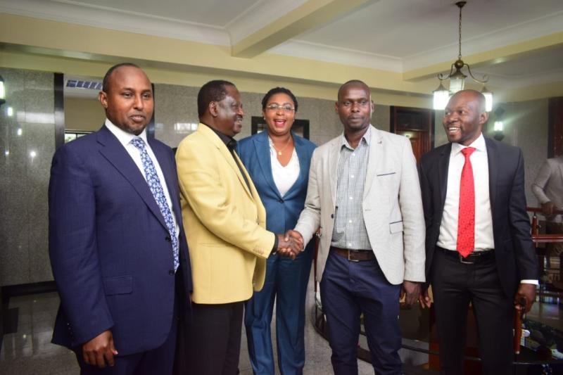 ODM Party Leader Raila Odinga shake hands with Kibra by-election candidate Imran Okoth with him are Suna MP Junet Mohamed and Malindi MP Aisha Jumwa (Photo: Boniface Okendo)