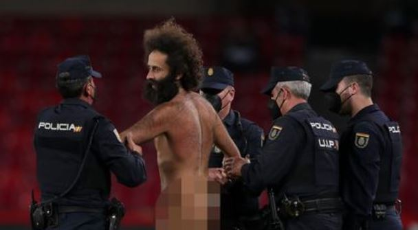 PHOTOS: Manchester United match interrupted by naked man as police intervene