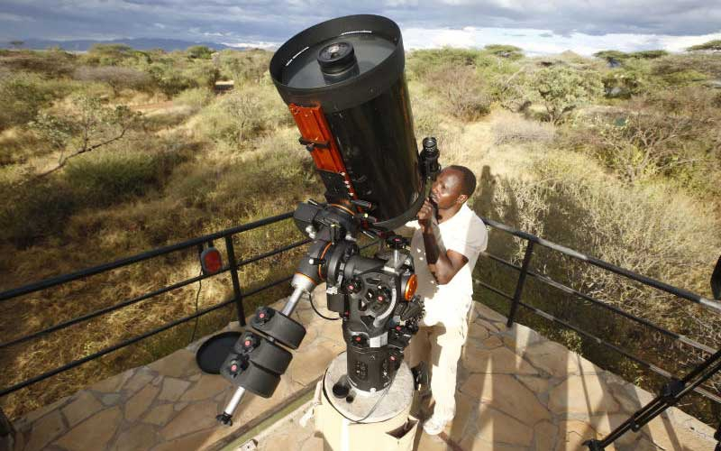 Tumbili Cliff Lodge manager operating the Celestron 14 that he uses to spy on the universe. [Kipsang Joseph]