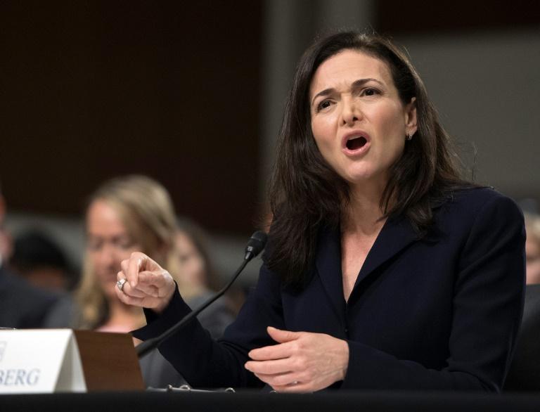 Facebook board defends besieged executive