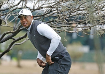 Tiger Woods returns with more curiosity than expectations