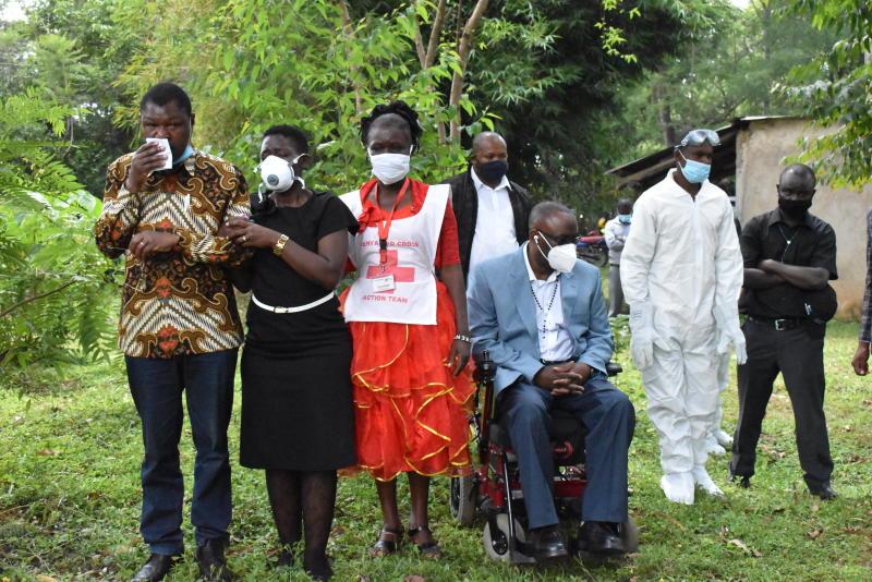 Bungoma Senator Moses Wetangula (left), Westlands MP Tim Wanyonyi (in wheelchair) during the burial of their brother Anthony Waswa.(Photo: Mumo Munuve)