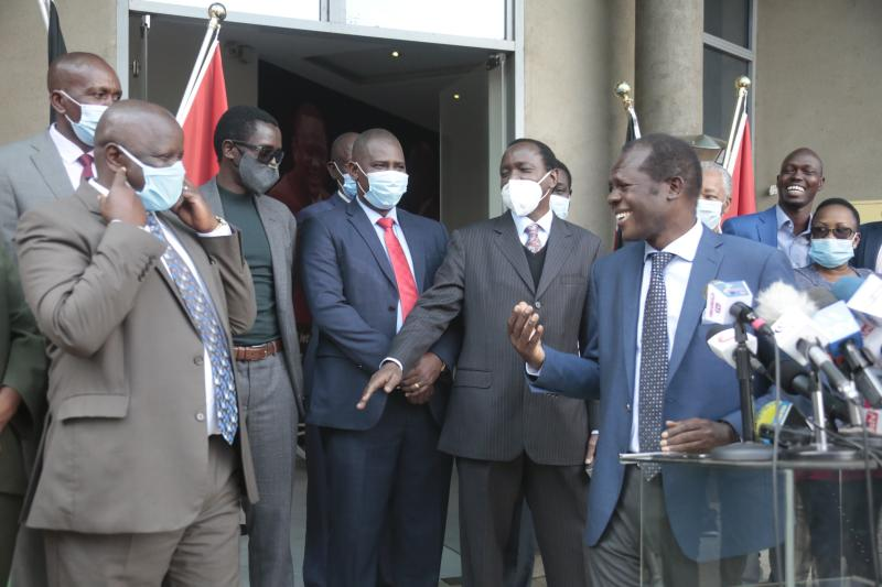 Jubilee Secretary General Raphael Tuju(2nd left) and his Vice Chairman David Murathe(right) with Chama Cha Mashinani(CCM) Party Leader Isaac Ruto and Wiper Party Leader Kalonzo Musyoka addressing the
