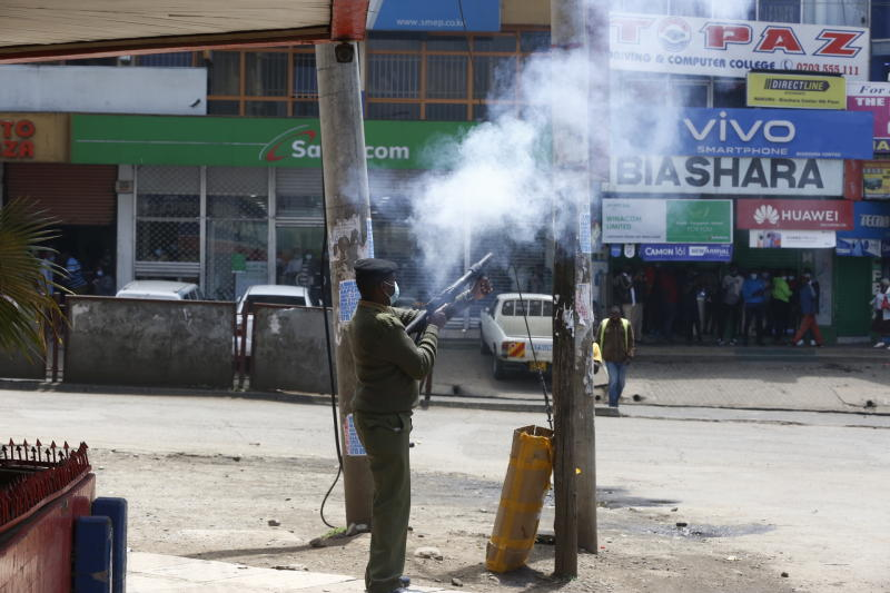 A police officer engage demonstrating matatu operators in Nakuru Town (Photo: Kipsang Joseph,Standard)