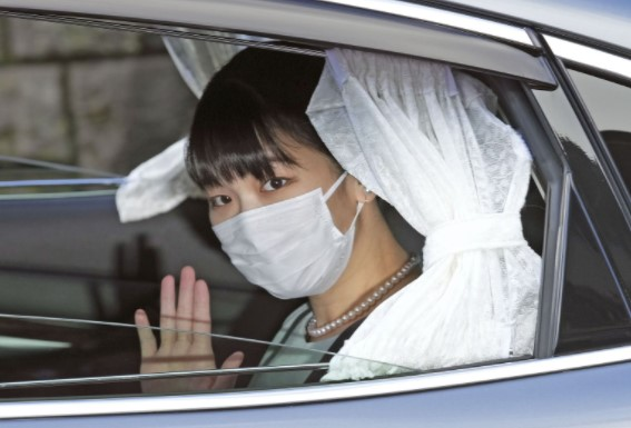 Japan's princess Mako gives up title as she weds her college sweetheart