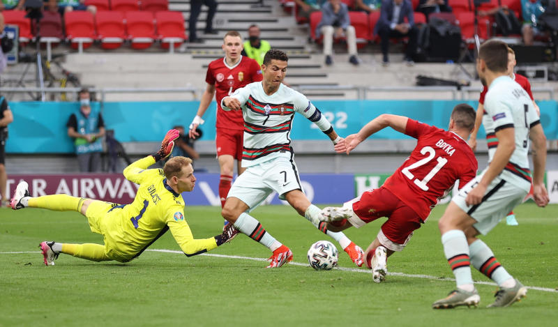 Record-breaking Ronaldo strikes late as Portugal sink Hungary