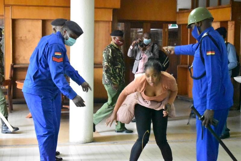 Mlango Kubwa MCA Patricia mutheu being roughed by police officers at the Nairobi County Assembly restaurant where she had sought refuge. (Photo: Samson Wire)