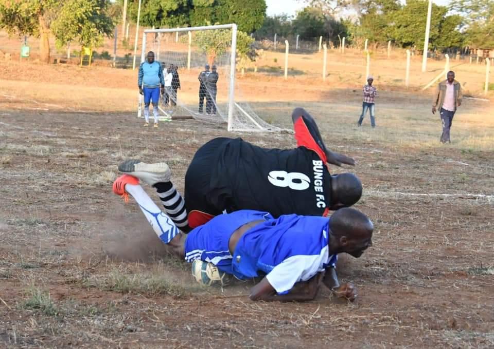 Elgeyo-Marakwet Senator Kipchumba Murkormen falling down after a tackle in a friendly football match in Kitui