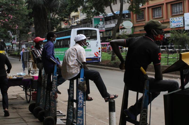 Handcart pullers keep social distance as they wear masks along Tom Mboya Street (Photo: Collins Kweyu)