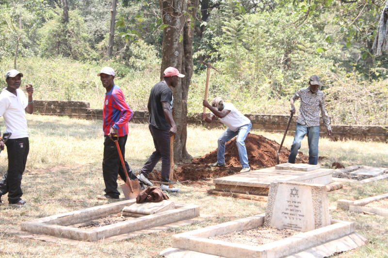 A group of men digging the grave where the slain Dutch businessman Tob Cohen will be laid to rest. (Photo: Edward Kiplimo)