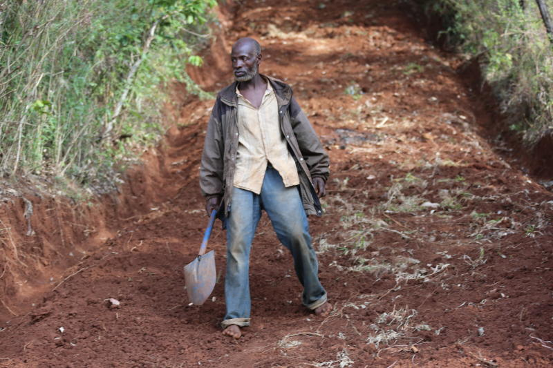 For six days, Muchami toiled, digging away at the slope to create a road. (Allan Mungai/ Standard)