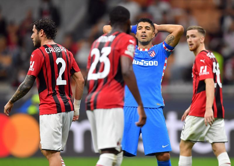 Champions League: Last-gasp Suarez penalty earns Atletico victory over 10-man Milan