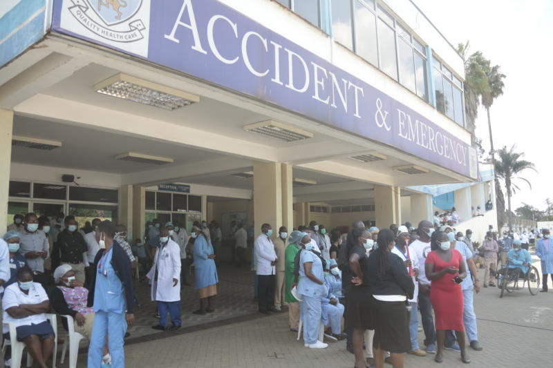 KNH medical workers who are on strike assemble outside the medical facility. (Photo: Boniface Okendo)