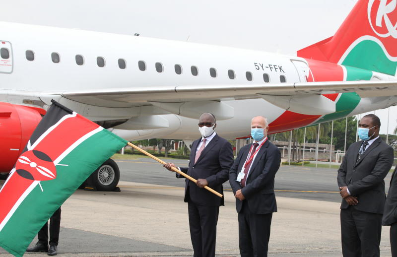 Transport CS James Macharia and Michael Joseph (left) flagging off domestic flights which resumed operations on Wednesday, July 15, 2020. (Photo: Jonah Onyango)