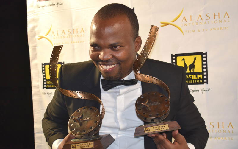 MC Jessy is all smiles with his awards