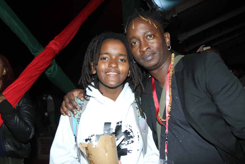 Eric Wainaina (right) and his daughter Seben Mwaniki during the UB 40's 'Real Labour of Love' tour concert at the Carnivore grounds .[Elvis Ogina,Standard]
