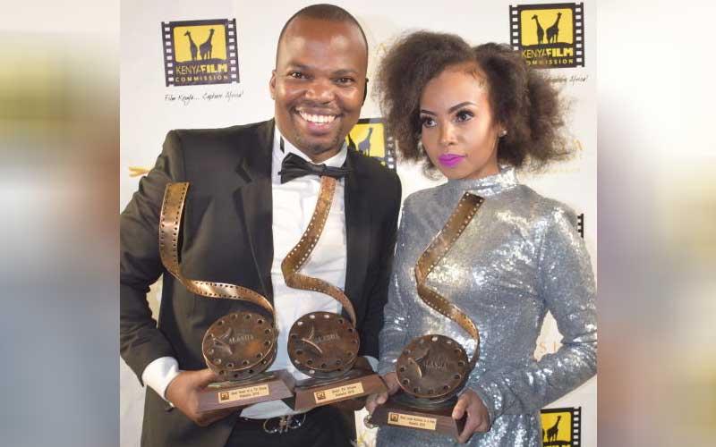 MC Jessy with Brenda Wairimu with their awards