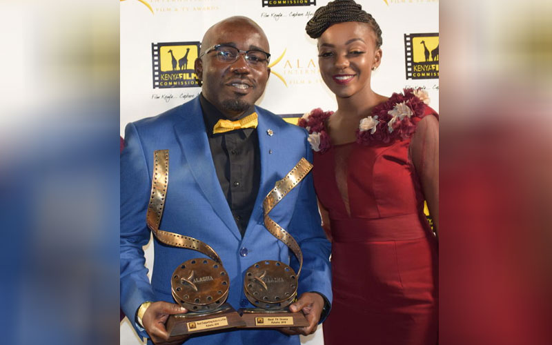 Reuben Odanga and Celestine Gachuhi hold their awa