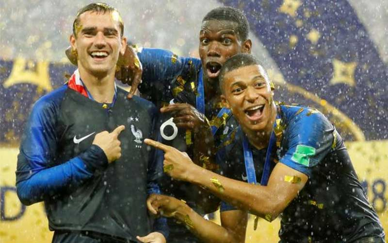France's Antoine Griezmann, Paul Pogba and Kylian
