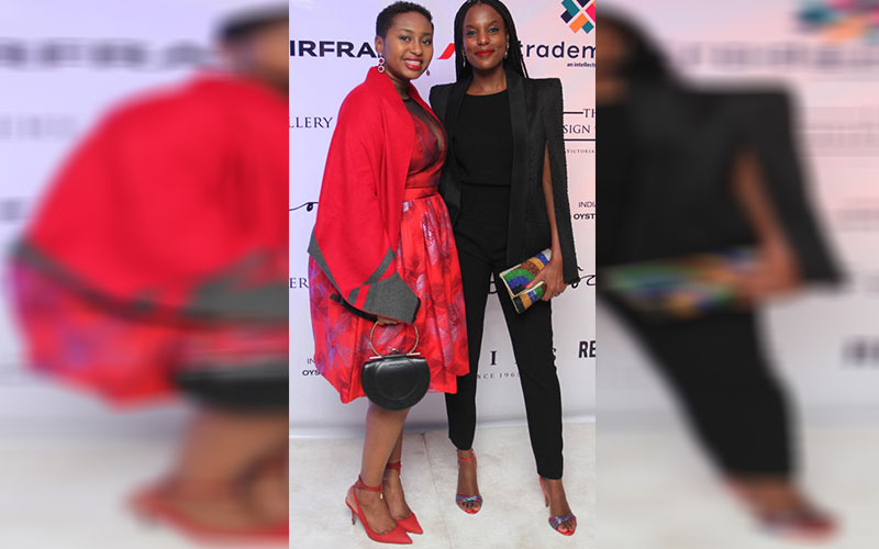 Judith Mongala and Liza Ntungicimpaye pose for a p
