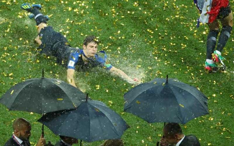 France's Benjamin Pavard celebrates winning the Wo