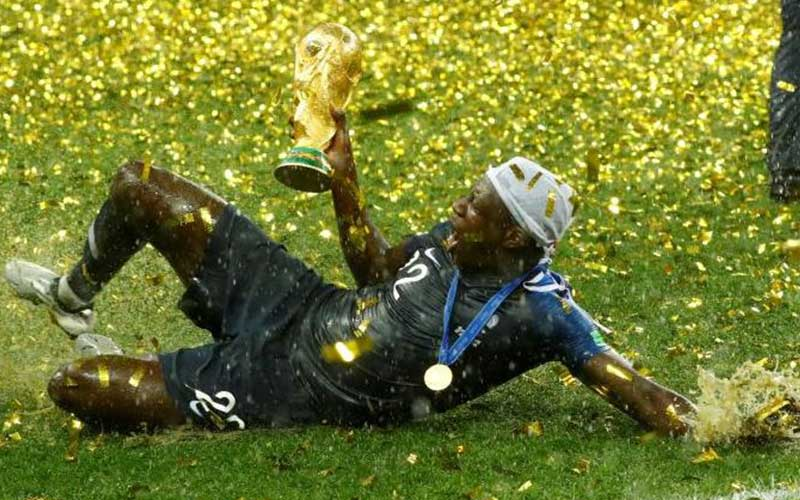 France's Benjamin Mendy celebrates with the trophy