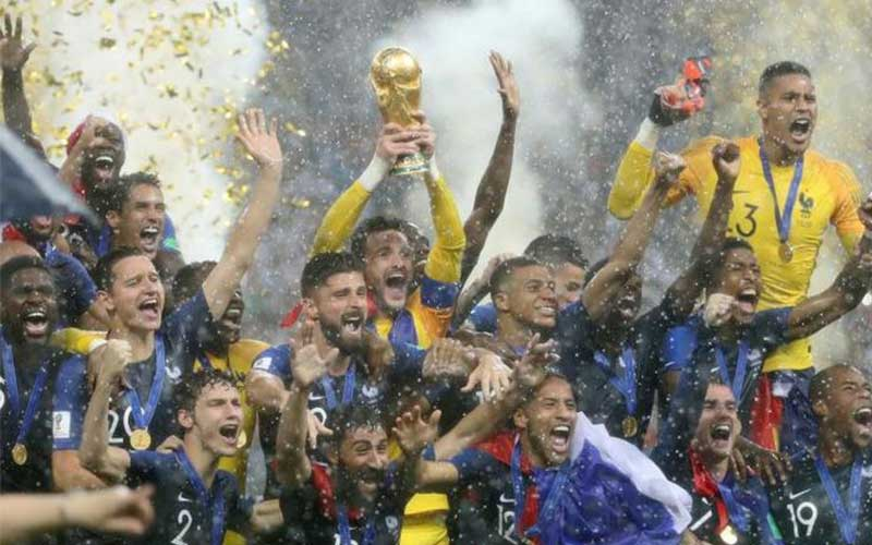 France's Hugo Lloris lifts the trophy as they cele