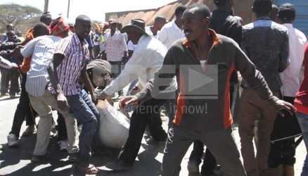 Manna from 'heaven': Residents scramble for bags of maize after truck overturns