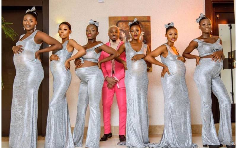 Male Nigerian socialite turns heads with his six pregnant women at wedding