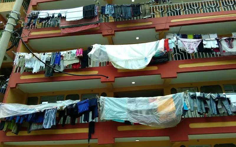 Concrete slum? Why Pipeline residents cover wet clothes with plastic bags