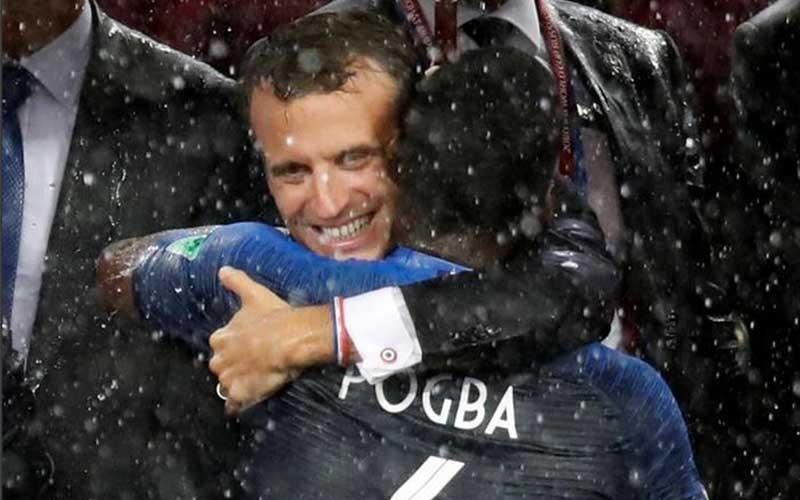 France President Emmanuel Macron embraces Paul Pog