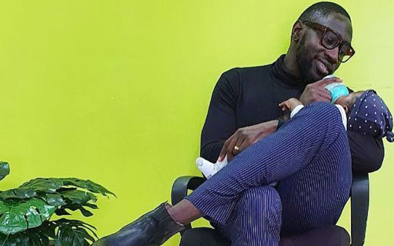 Sauti sol's Polycarp Otieno takes break from group to bond with newborn son