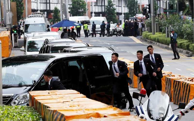 Kim Jong-un's jogging bodyguards flank his limousine ahead of Trump meeting