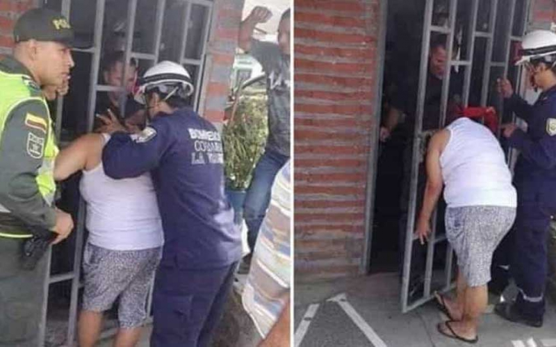 Peeping woman gets head stuck in neighbour's gate for hours